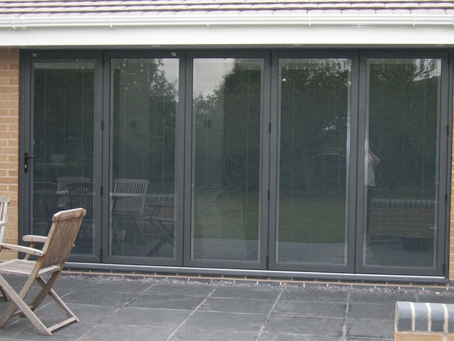 Closer View Of Central Door With Magnetic Slider Operated Blinds.