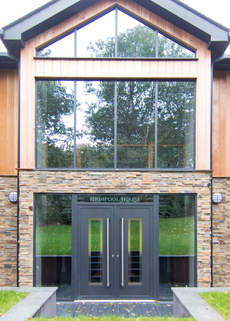 Impressive Front Door with full height stainless steel pull handles
