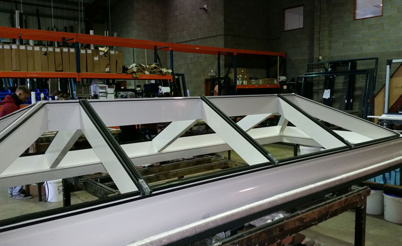 Factory view of the Alumen large span lantern without top cappings.