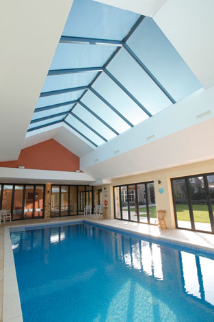 Swimming pool rooflight showing bifolding doors