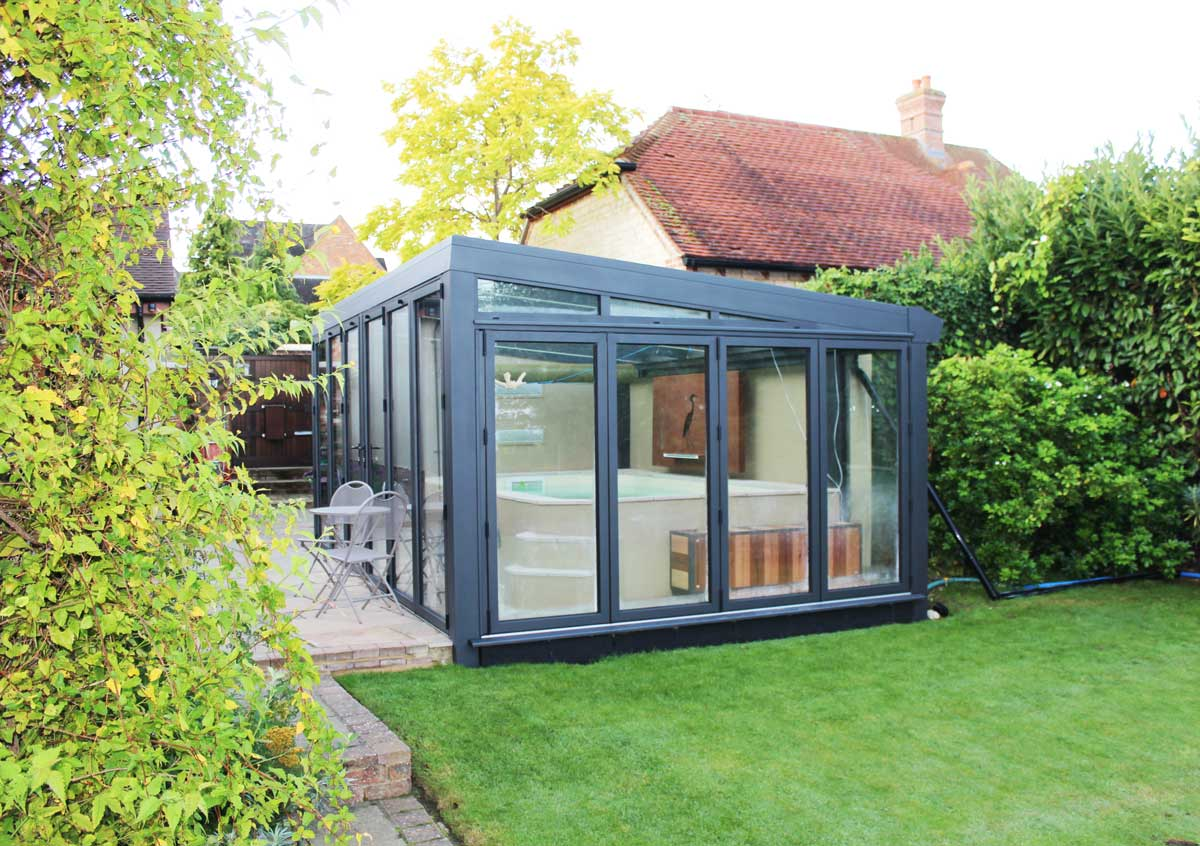 External view of the conservatory which joins onto a brick built pool house