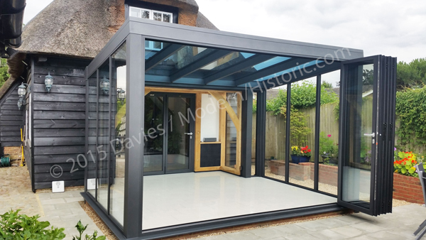 Contemporary glass extensions in conservation area for Modern garden room extensions
