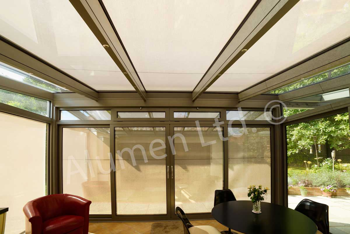 Conservatory room with both vertical and roof awnings down