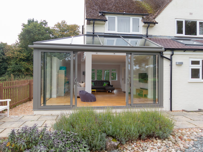Hipped Aluminium Conservatory Roof with SMART Visoglide Plus Sliding Doors.