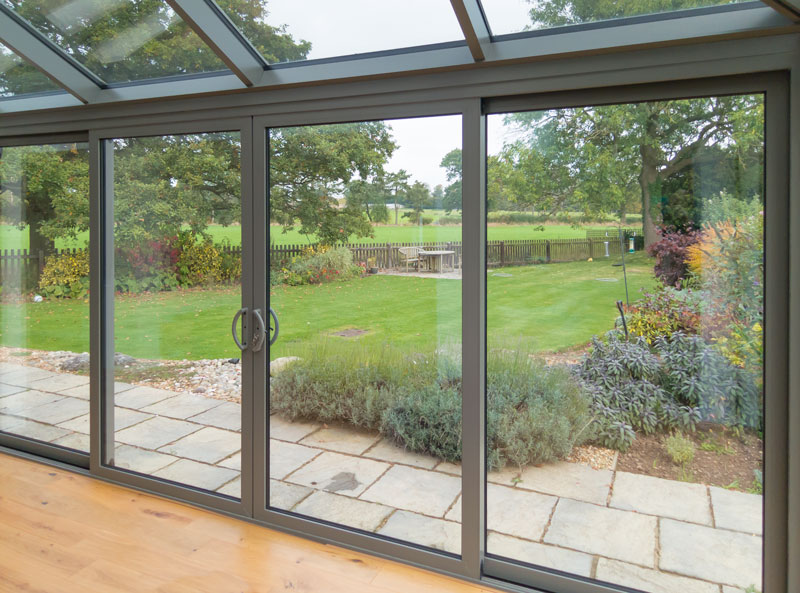 Smart visoglide inline sliding patio door aluminium for Patio doors folding sliding