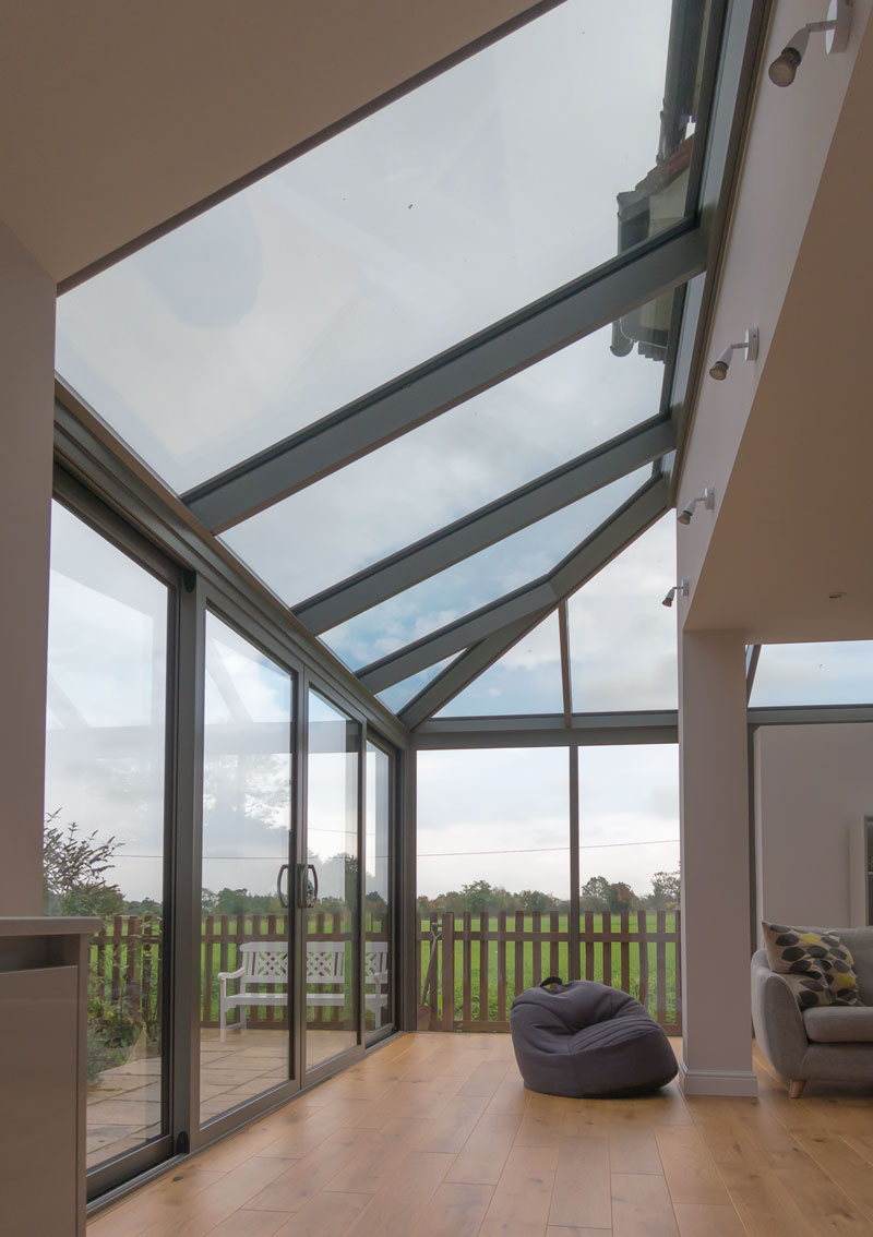 Hipped roof provides a great way to integrate the glazed extension with the room .